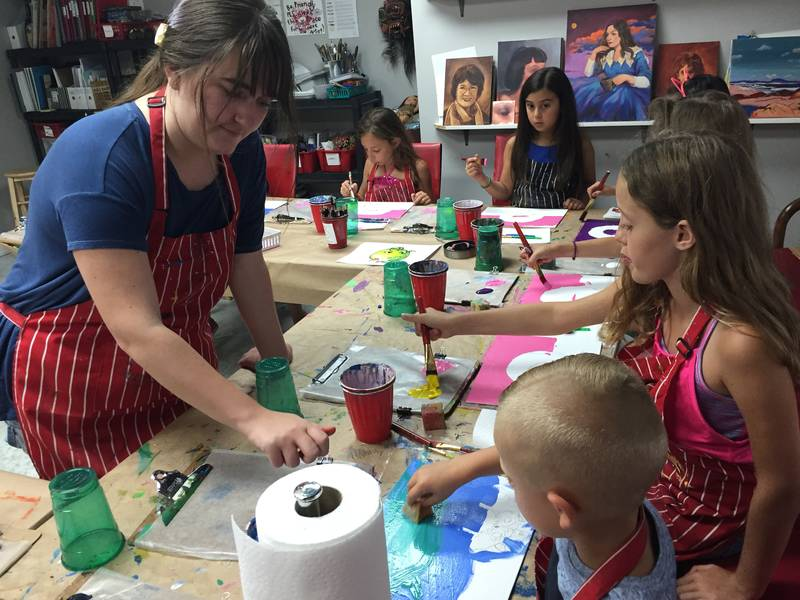 One of our instructors, Izzy, leading the painting activity during one of our Art Parties.