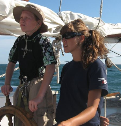 Young trainee learning to helm