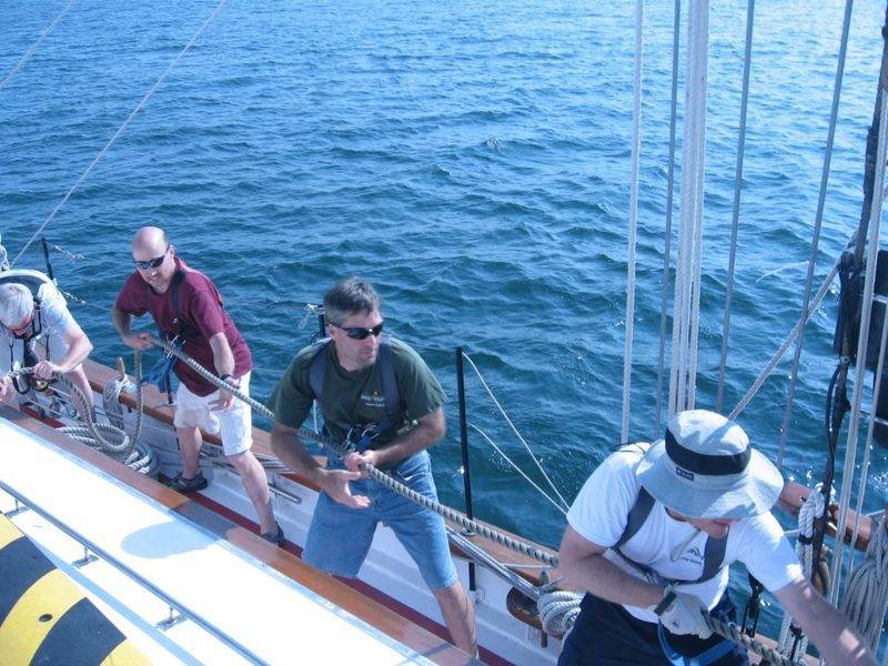 It takes teamwork to haul the sails!