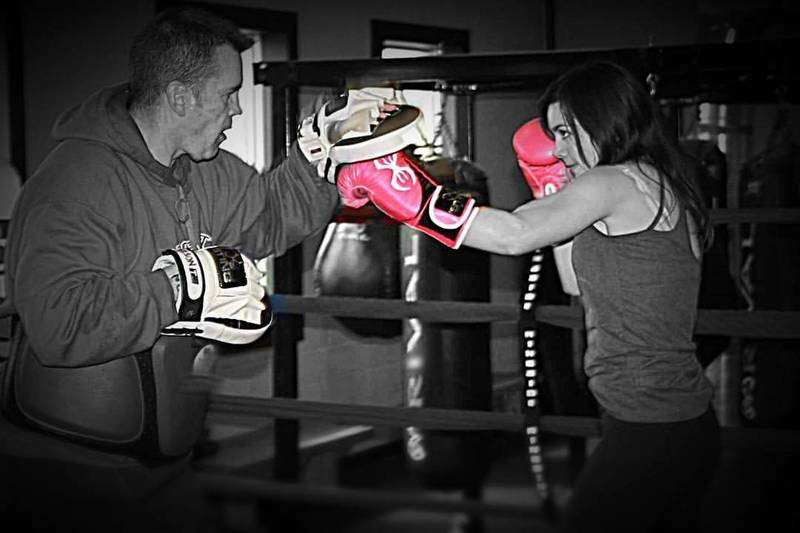 Coach Don doing some pads with his daughter Grace