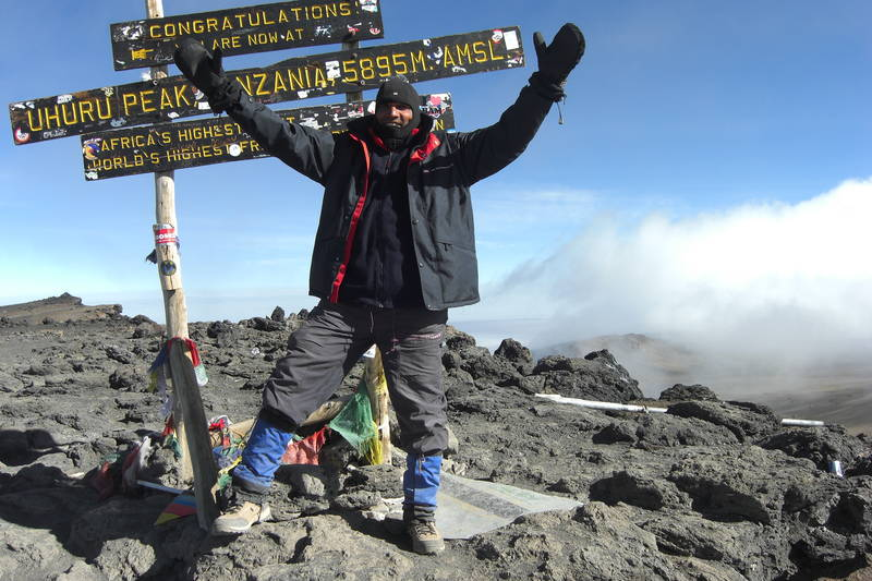 Founder at the highest point of Africa - Mount Kilimanjaro